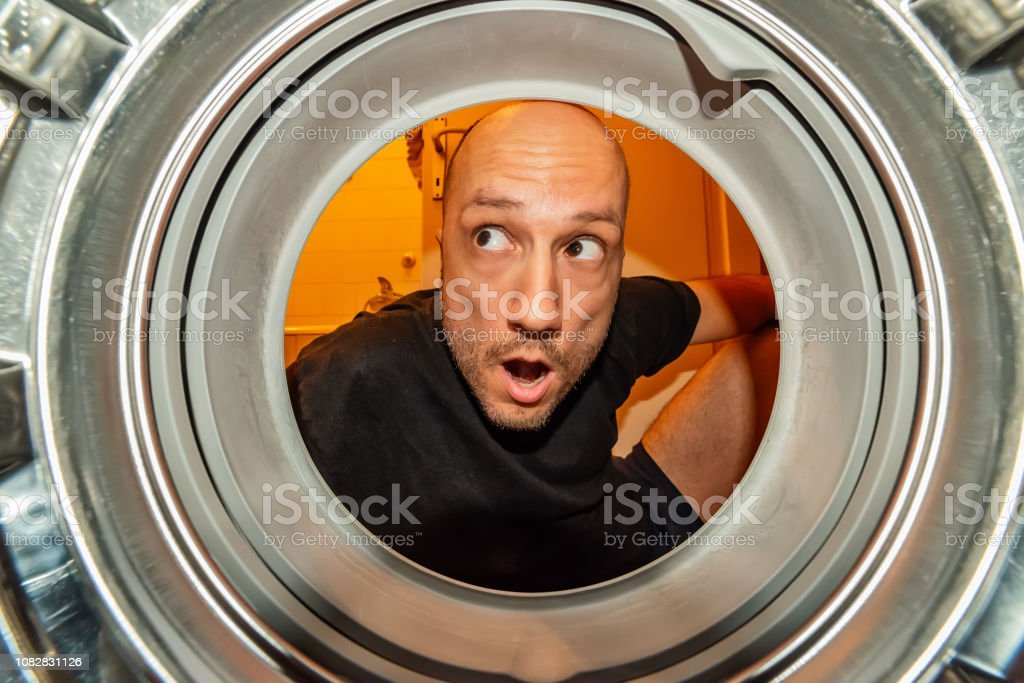 Portrait of man view from washing machine inside. What is that thing...