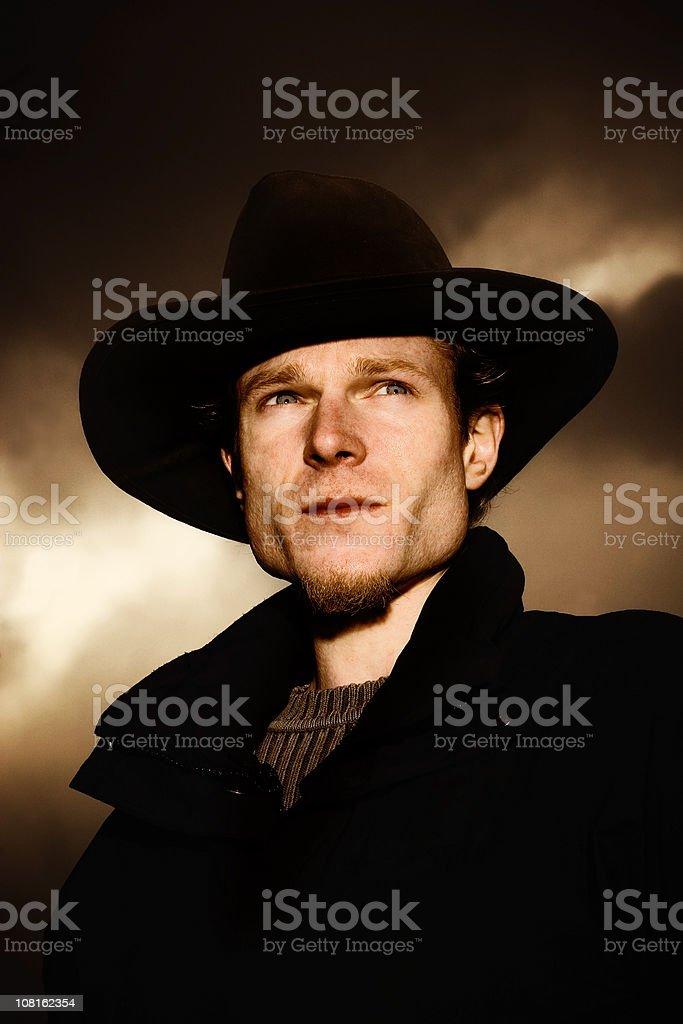 Portrait of Man Wearing Black Cowboy Hat, Toned royalty-free stock photo