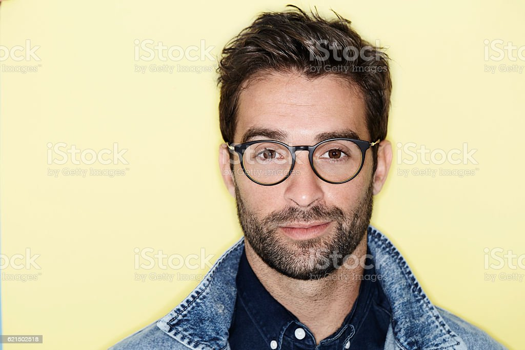 Portrait of man wearing spectacles and denim Lizenzfreies stock-foto