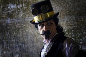 istock portrait of man wearing steampunk, victorian style clothing 478060882