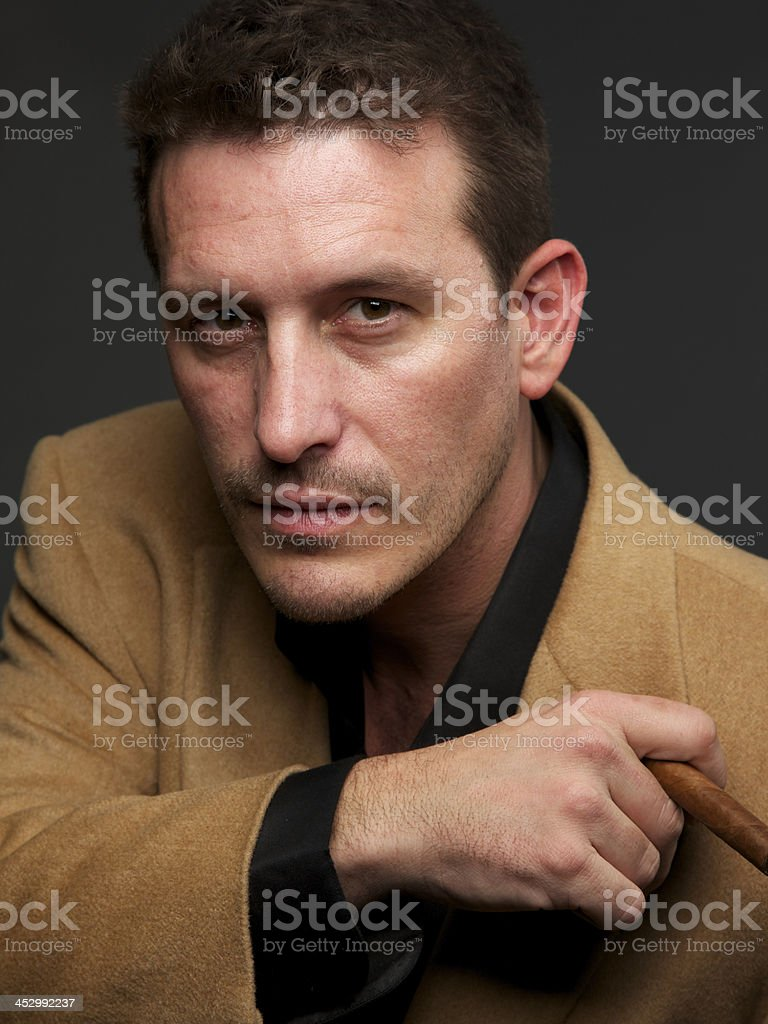 Portrait of man with camel hair coat and cigar stock photo