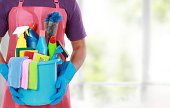 Portrait of man with cleaning equipment ready to clean house