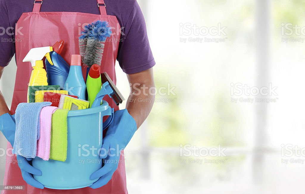 Portrait of man with cleaning equipment stock photo