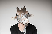 Portrait of man with giraffe mask