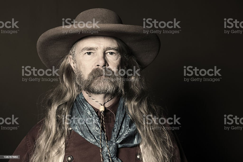 e3b123ac893 Portrait Of Man With Long Hair Wearing Cowboy Hat Stock Photo   More ...