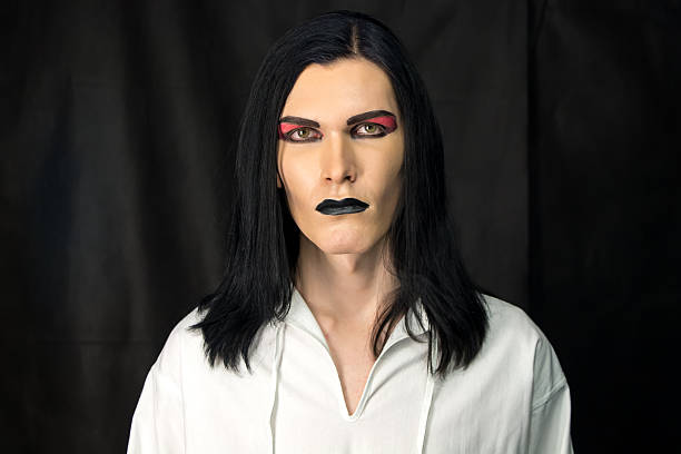 Portrait of man with make up Portrait of man with make up on black background goth stock pictures, royalty-free photos & images