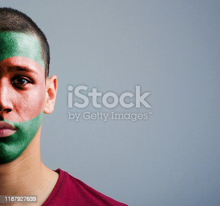 Portrait of man with painted flag of Bangladesh