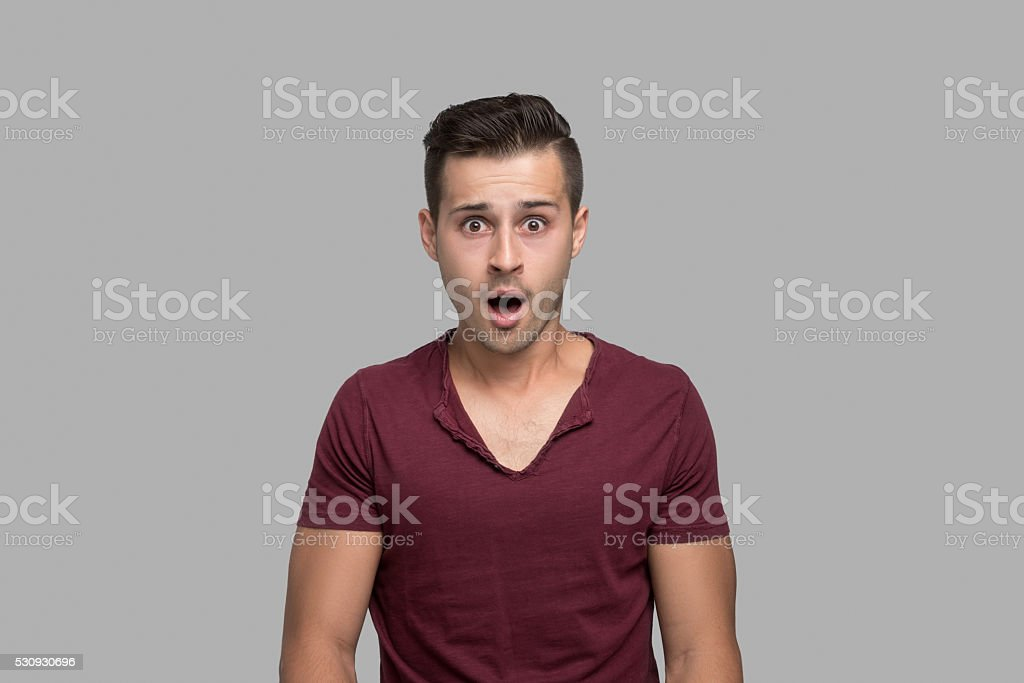 Portrait of man with shocked expression stock photo