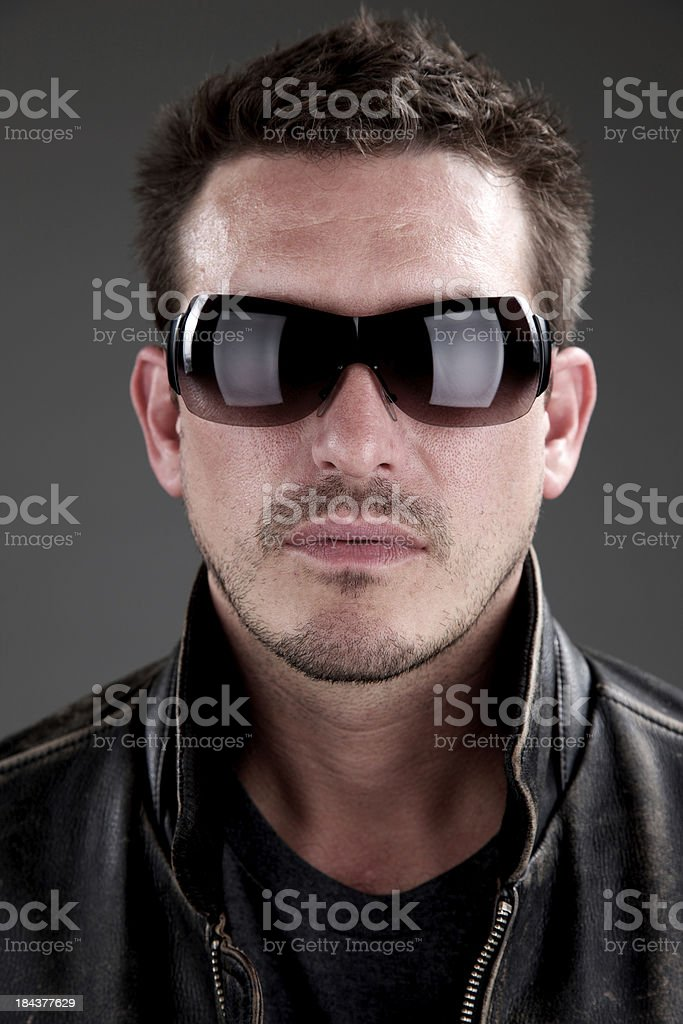 Portrait of man with sunglasses and leather jacket stock photo