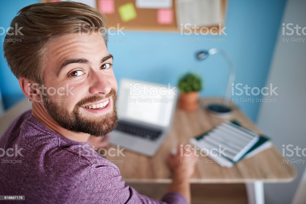 Portrait of man working on the computer stock photo