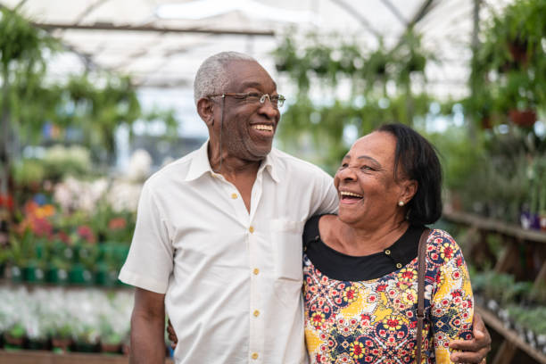 Portrait of Mature African Couple Customer at Flower Market Real People brazilian ethnicity stock pictures, royalty-free photos & images