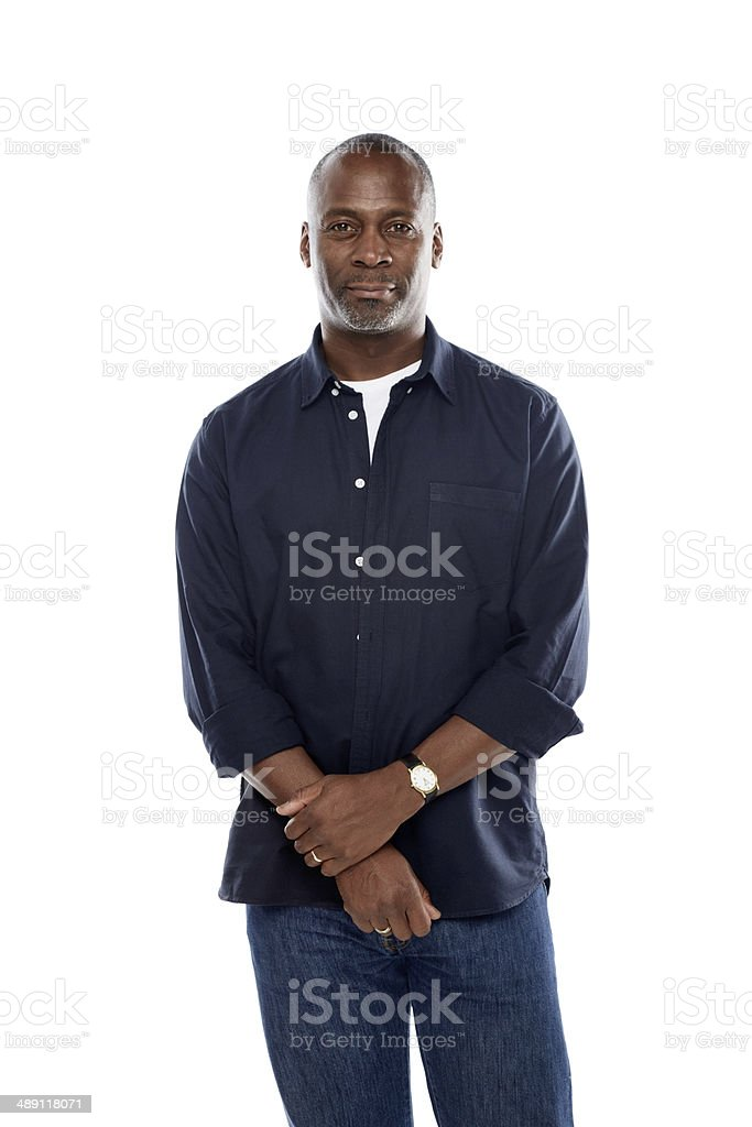 Portrait of mature african man standing peacefully stock photo