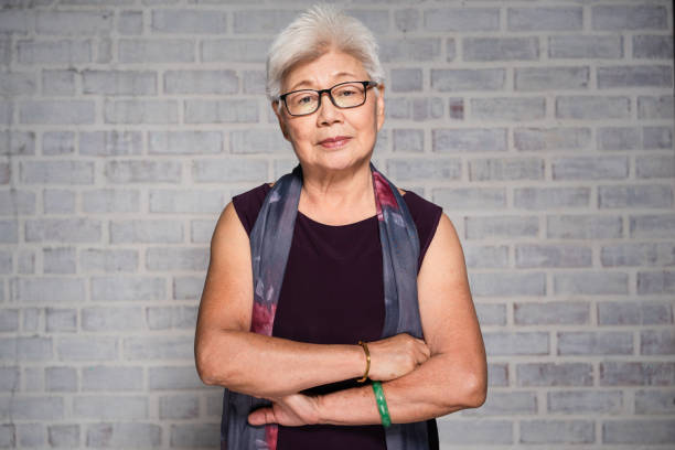 portrait of mature asian woman. - cultura orientale foto e immagini stock