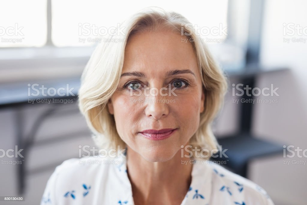Portrait of mature business entrepreneur stock photo