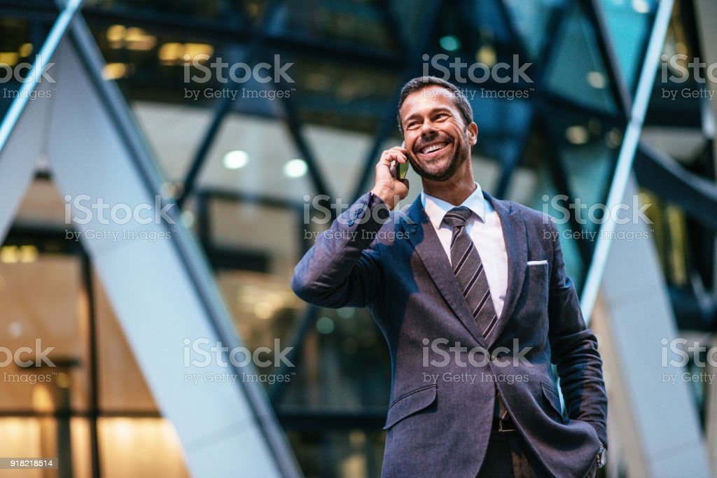 Portrait of mature business person with mobile phone stock photo