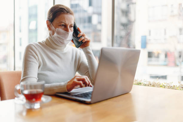 portrait of mature business woman with face mask - coronavirus stock pictures, royalty-free photos & images
