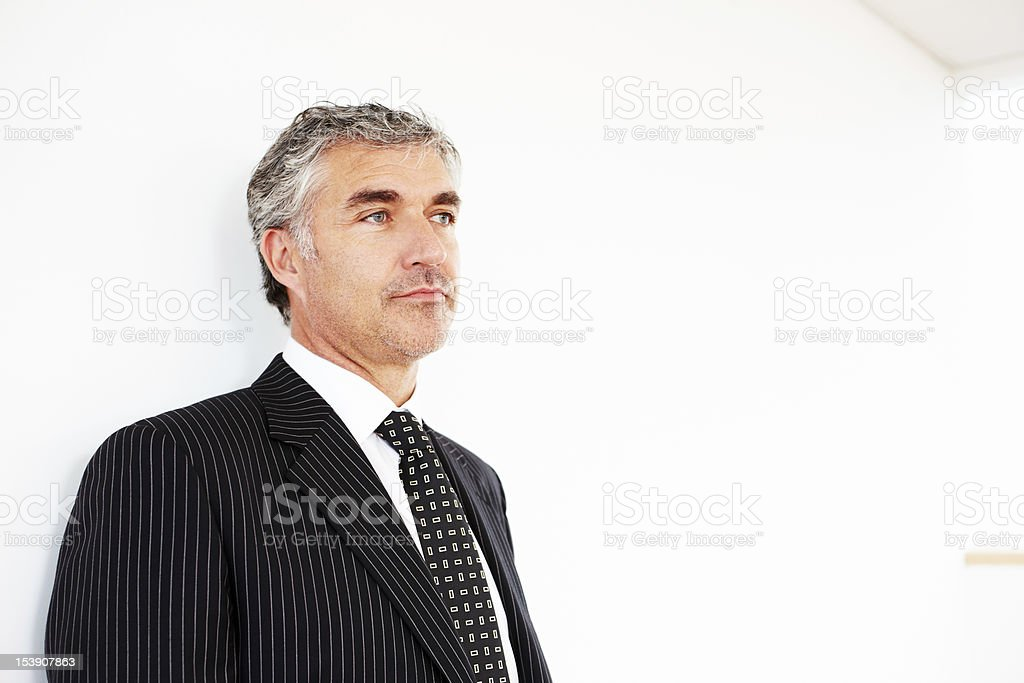 Portrait of mature businessman looking away royalty-free stock photo