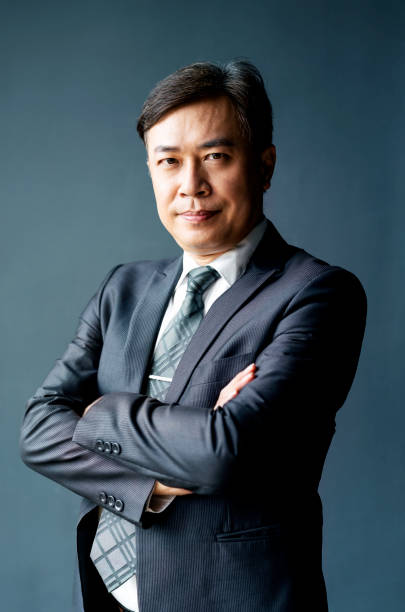 Portrait of mature businessman with arms crossed stock photo