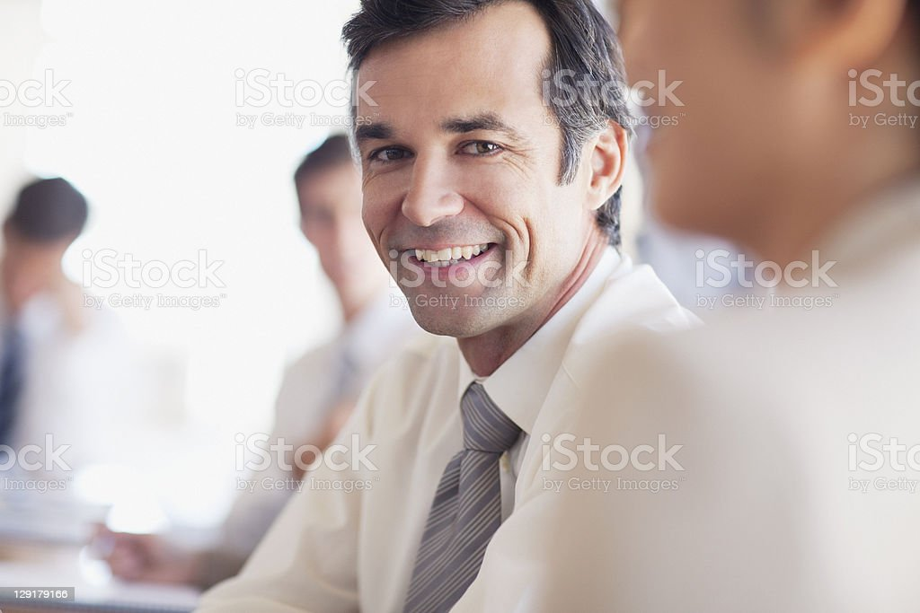 Portrait of mature businessman with colleagues royalty-free stock photo