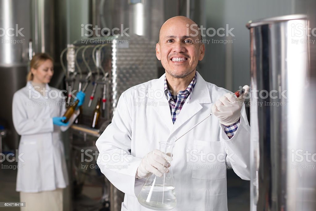 Portrait of mature cheerful male brewery worker stock photo