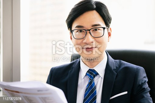960195072 istock photo Portrait of mature Chinese businessman in glasses smiling 1127372378
