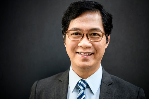825083248 istock photo Portrait of mature Chinese businessman in glasses smiling 1200064760