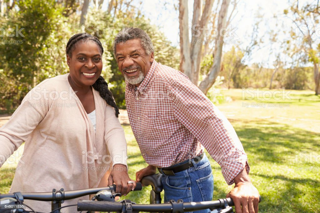 Portrait Of Mature Couple Going For Cycle Ride In Park stock photo