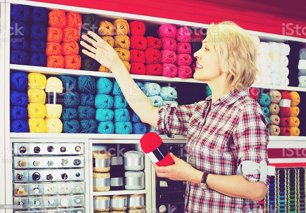 portrait of mature female customer standing  in shop royalty-free stock photo