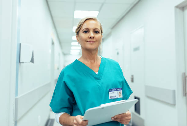Portrait of mature female nurse working in hospital stock photo