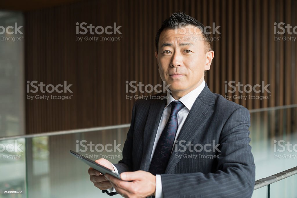 Portrait of mature Japanese businessman with tablet – Foto