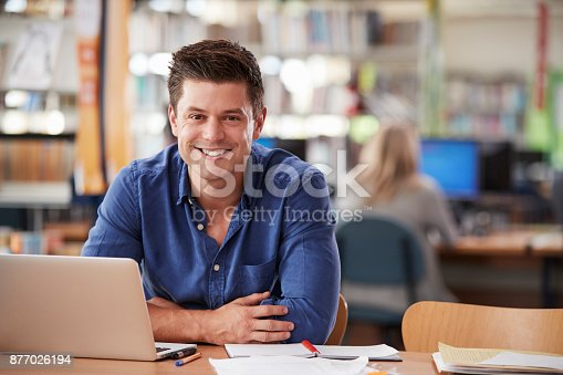istock Portrait Of Mature Male Student Using Laptop In Library 877026194