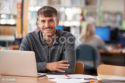 istock Portrait Of Mature Male Student Using Laptop In Library 877026360
