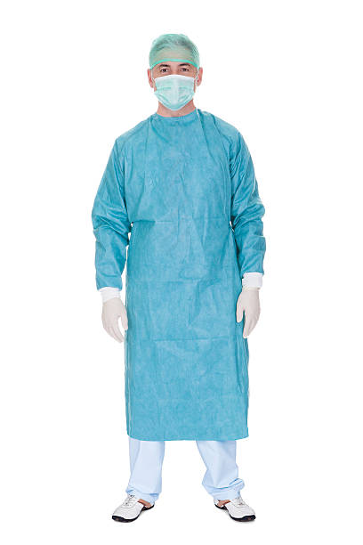 portrait of mature male surgeon - protective mask workwear stock pictures, royalty-free photos & images