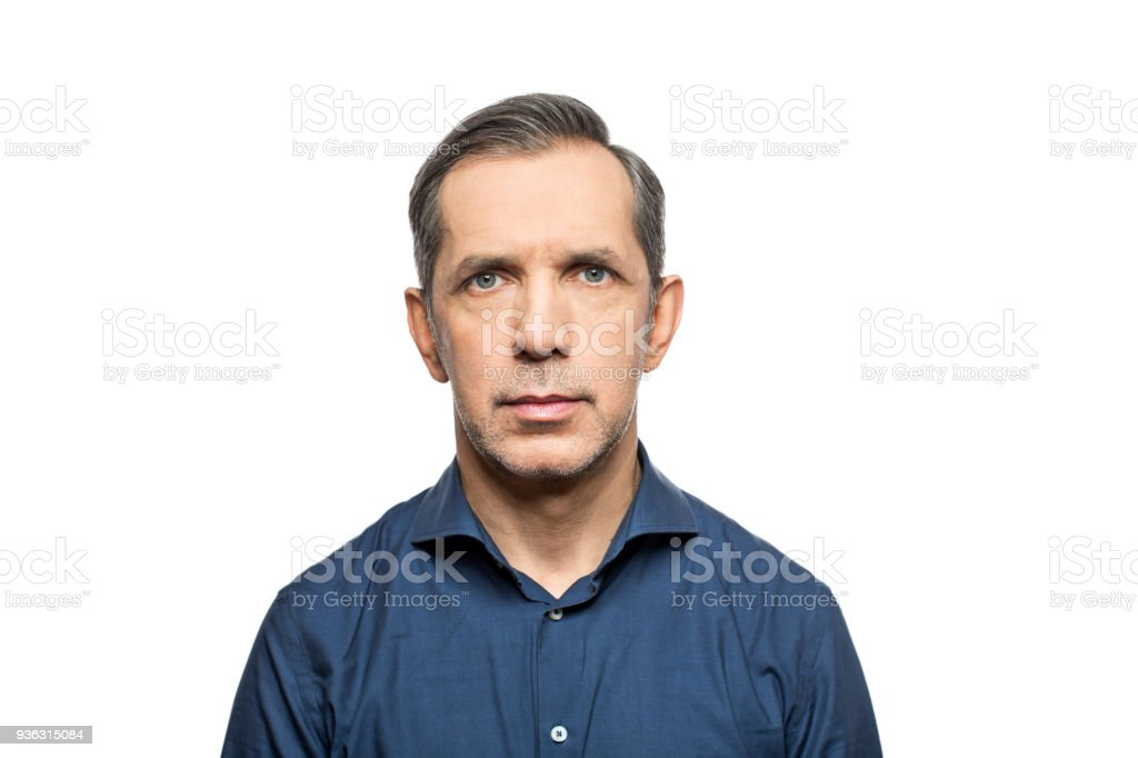 Portrait of mature man against white background stock photo