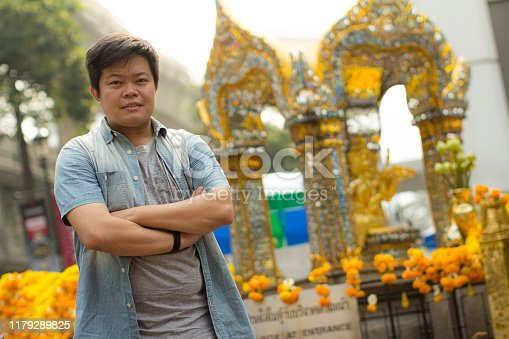 Portrait of mature man at erawan shrine