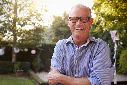 istock Portrait Of Mature Man In Back Yard Garden 643324930
