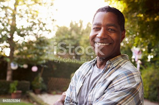 istock Portrait Of Mature Man In Back Yard Garden 643325254