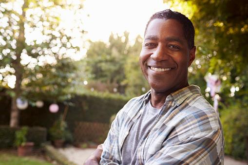 istock Portrait Of Mature Man In Back Yard Garden 643325254