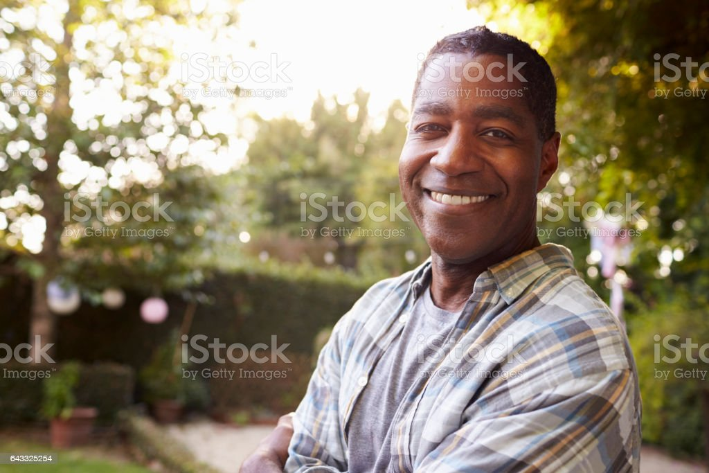 Portrait Of Mature Man In Back Yard Garden stock photo