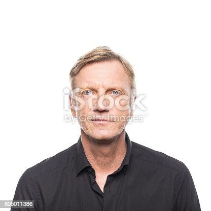 805011368 istock photo Portrait of mature man in black shirt 805011386