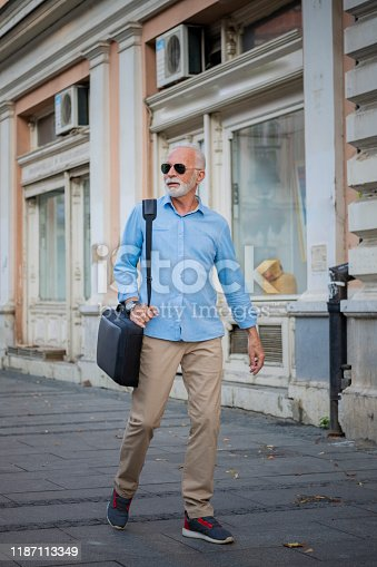 636248376istockphoto Portrait of Mature Man in Business Suit in the City Center 1187113349