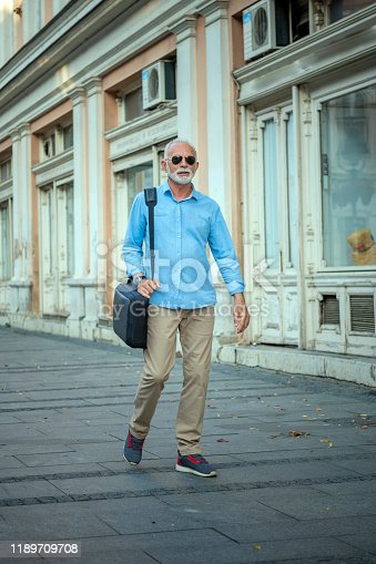 636248376istockphoto Portrait of Mature Man in Business Suit in the City Center 1189709708