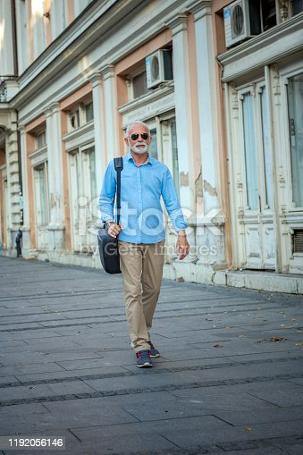636248376istockphoto Portrait of Mature Man in Business Suit in the City Center 1192056146