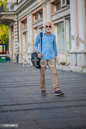 636248376istockphoto Portrait of Mature Man in Business Suit in the City Center 1192449572