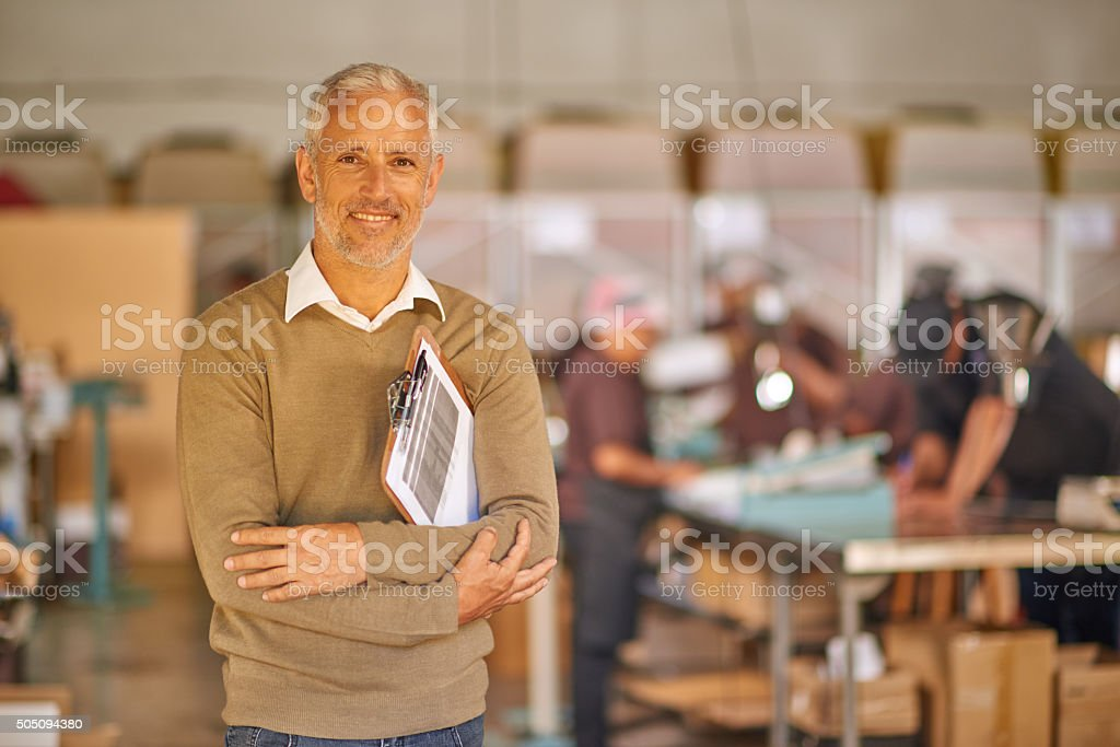 Portrait of mature man in warehouse stock photo