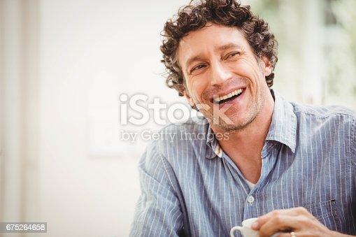 istock Portrait of mature man smiling 675264658