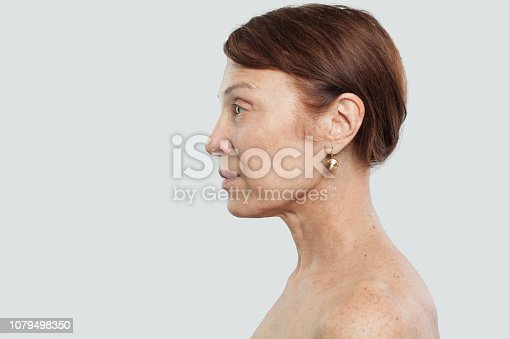 istock Portrait of mature woman. Facial treatment, cosmetology and aesthetic medicine concept 1079498350