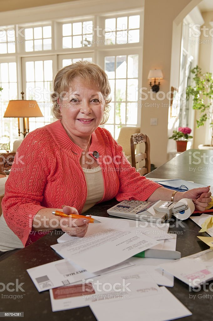 Portrait of Mature Woman Home Budgeting royalty-free stock photo