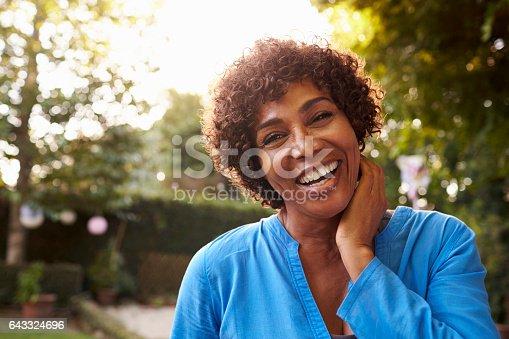 istock Portrait Of Mature Woman In Back Yard Garden 643324696
