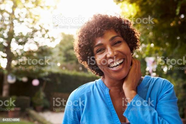 Portrait of mature woman in back yard garden picture id643324696?b=1&k=6&m=643324696&s=612x612&h=yhxba2cng6evnycigedw vv9n2dwda88zjb6fazct2i=